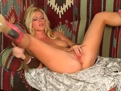 Blonde temptress, named Niki Young, demonstrates on the camera how that babe masturbates her pussy. Hottie makes her hole juicy by gentle touches on her sensitive boobies.