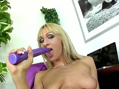 Provocative whorish golden-haired milf Cherry Cream with cheep enormous make up and lengthy nails in nylons and high heels teases and stuffs wet cunt with lengthy violet vibrator to orgasm.