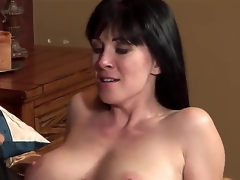 The young handsome pornstar Johnny Castle seduces his allies MILF mamma RayVeness with a big natural boobies. That guy begins to kiss her lovely lips and helps to undress. They look very happy.