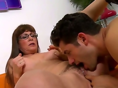 Brunette milf with long hair and glasses Alexandra Silk gets her hairy cunt licked and fingered by a turned on stud Giovanni Francesco on the daybed i the living room and enjoys