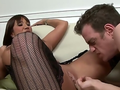 Gorgeous and tanned black haired milf Ava Devine in black hot nylons gets her shaved taco licked by Chad Diamond after giving him a hot oral sex session in living room