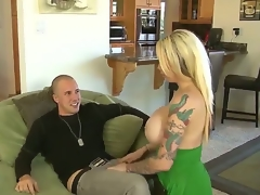 Blonde and really arousing milf Candy Manson with tattooed arm and big firm honkers gives juvenile aroused chap Jessy Jones a hot blow job pleasant session on the couch in living room