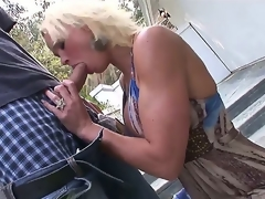 Youthful construction stud Chris Johnnson understands that blond MILF Rhylee Richards means business when this babe kneels down and begins blowing him right in her backyard!
