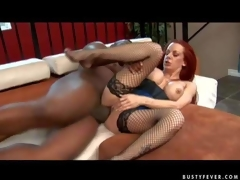 Experienced curvy redhead milf Shannon Kelly with large fake balloons and bouncing booty in fishnet stockings receives her shaved minge pounded hard by tall black hunk to loud orgasm