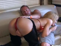Busty mature blonde momma with big boobs in sexy cowgirl panties and red bikini enjoys in teasing her lover and giving head on the couch in front of the livecam