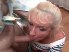 Mature whore in fishnets and petticoat sucks cocks