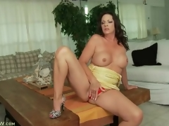 Taut yellow costume on curvy brunette hair milf