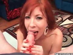 Redhead milf with arousing large breasts gives a handjob