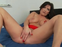 Curvy solo milf masturbates and fingers in ottoman
