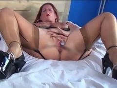 Older redhead in sexy lingerie masturbates