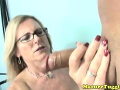 Tugjob loving milf with spex tugs cock