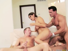 The brunette's pink wet vagina is eager to acquire drilled by those 2 large cocks