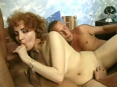 Hot Jammie thinks that that babe still has what it takes to be in porn and here in her audition, she's ganged up by 3 hot men. They play with her mature titties then get her down on all fours so they could plug her from the one and the other ends with a weenie between her tits.