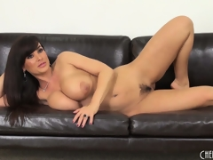 Lisa Ann acquires on the floor to toy and back on the couch to pose