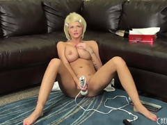 Breasty blond Joslyn toys her pussy and vibrates her clit on the couch, then gets on the floor