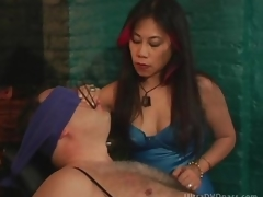 Mature Oriental Dominatrix Sits Pliant Male on the Bondage Chair